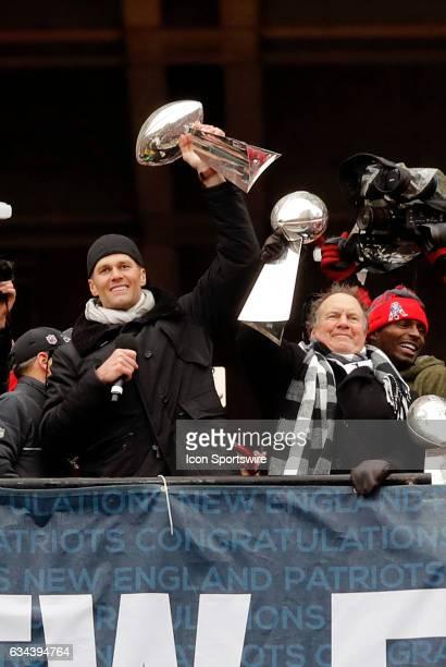 New England Patriots quarterback Tom Brady and New England Patriots head coach Bill Belichick hoist Vince lombardi trophies during the Patriots...
