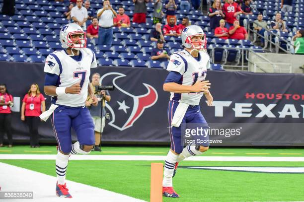 New England Patriots quarterback Tom Brady and New England Patriots quarterback Jacoby Brissett enter the field before the NFL preseason game between...