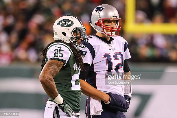 New England Patriots quarterback Tom Brady and New York Jets strong safety Calvin Pryor talk during the second quarter of the National Football...