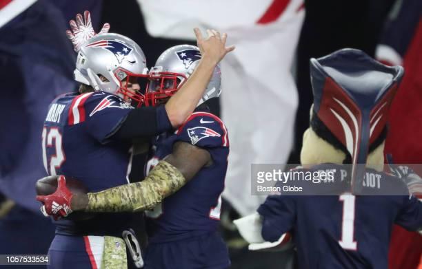 New England Patriots quarterback Tom Brady and teammate Josh Gordon celebrate after Gordon's touchdown during the fourth quarter The New England...