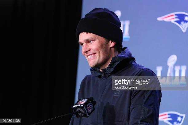 New England Patriots quarterback Tom Brady answers questions during the New England Patriots Press Conference wearing a glove on his right hand on...