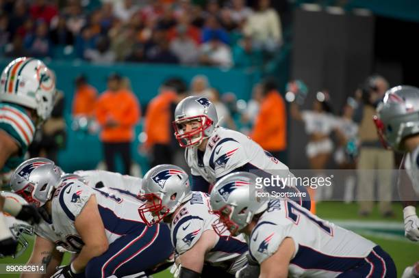 New England Patriots Quarterback Tom Brady at the line of scrimmage during the NFL football game between the New England Patriots and the Miami...