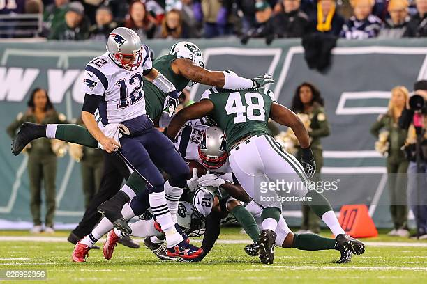 New England Patriots quarterback Tom Brady attempts to block for New England Patriots running back LeGarrette Blount during the first quarter of the...