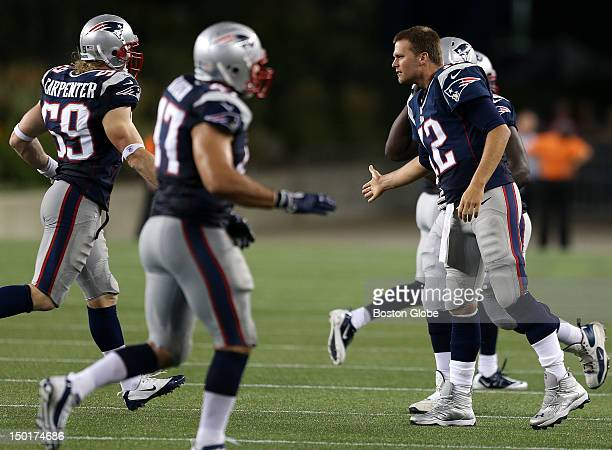 New England Patriots quarterback Tom Brady came out to congratulate the defense after stopping the New Orleans Saints field goal attempt during the...