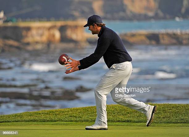 New England Patriots quarterback Tom Brady catches a football on the 18th green during the third round of the ATT Pebble Beach National ProAm at...
