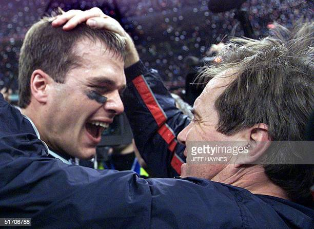 New England Patriots' quarterback Tom Brady celebrates with head coach Bill Belichick after their win over the St. Louis Rams 03 February, 2002 in...