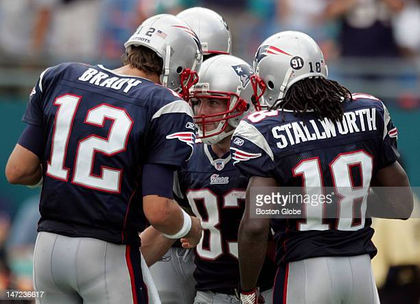 New England Patriots quarterback Tom Brady celebrates with teammate Wes Welker after Welker's 14yard touchdown reception against the Miami Dolphins...