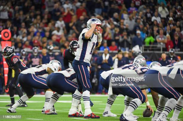 New England Patriots quarterback Tom Brady changes the play at the line during the football game between the New England Patriots and Houston Texans...