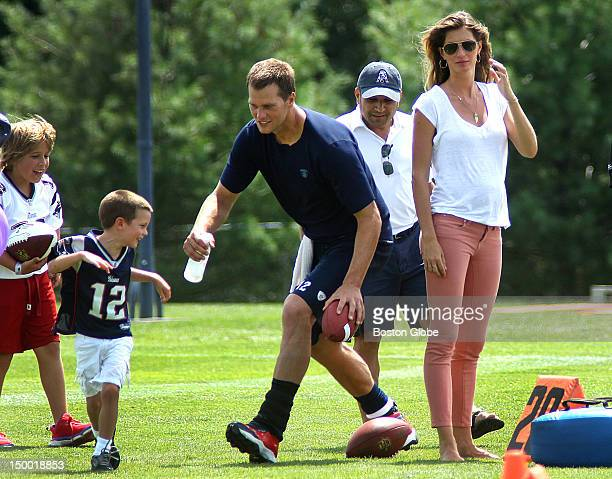 New England Patriots quarterback Tom Brady chases his son John as his wife Gisele Bundchen right looks on at the end of practice The New England...