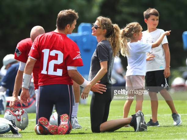 New England Patriots quarterback Tom Brady chats with his wife Gisele Bundchen as his daughter Vivian and son Benjamin right talk with each other...