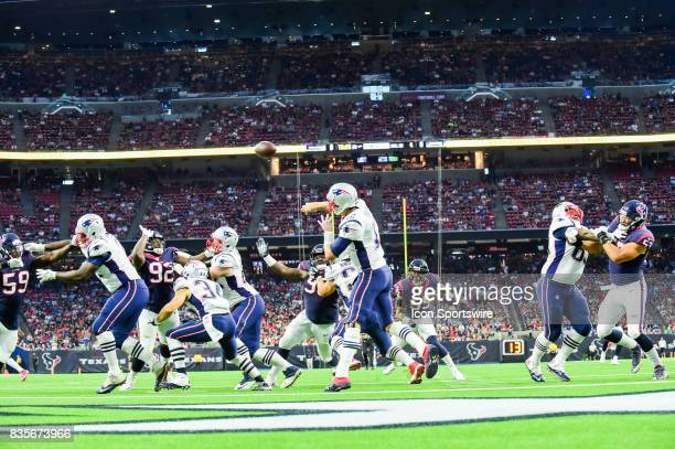 New England Patriots quarterback Tom Brady completes a pass to the flat during the NFL preseason game between the New England Patriots and the...