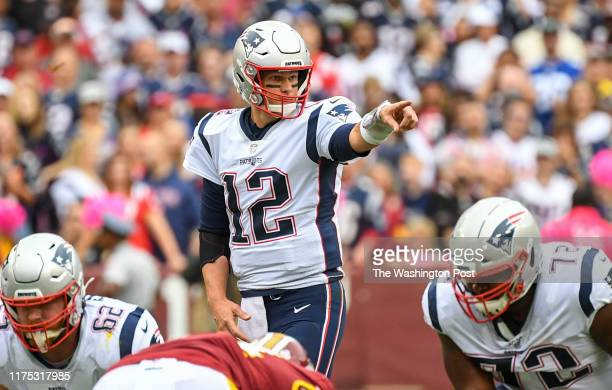 New England Patriots quarterback Tom Brady directs his offense during action against the Washington Redskins at FedEx Field.