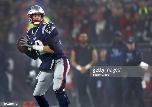 New England Patriots quarterback Tom Brady drops back to pass in the fourth quarter. The New England Patriots host the Tennessee Titans in the Wild...
