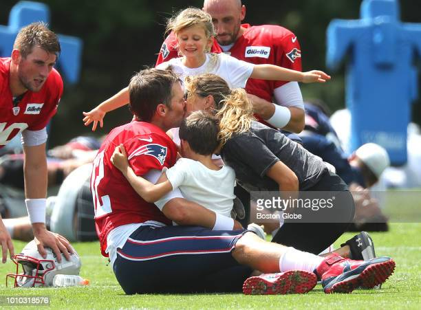 New England Patriots quarterback Tom Brady gets a group hug from his daughter Vivian son Benjamin and his wife Gisele Bundchen following Patriots...