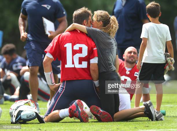 New England Patriots quarterback Tom Brady gets a hug and kiss from his wife Gisele Bundchen following Patriots training camp at the Gillette Stadium...