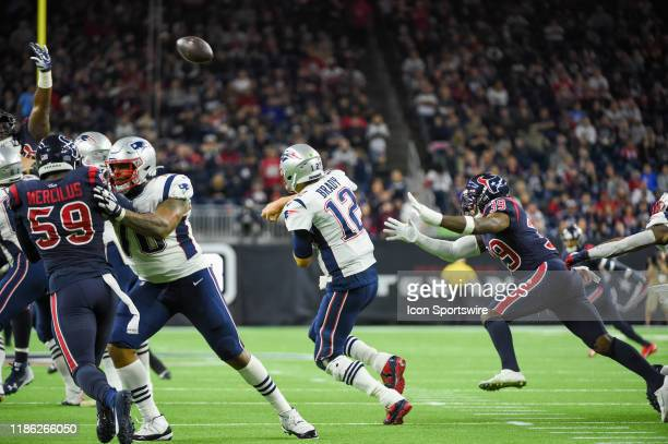 New England Patriots quarterback Tom Brady gets an off balance pass away as Houston Texans free safety Tashaun Gipson provides backside pressure...