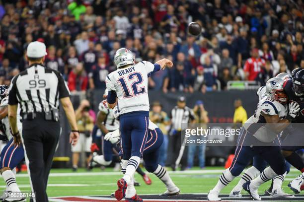 New England Patriots quarterback Tom Brady gets his pass away over the middle during the football game between the New England Patriots and Houston...