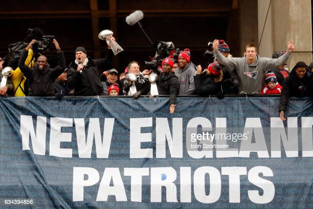 New England Patriots quarterback Tom Brady gets the crowd going during the Patriots Victory Parade through the streets of Boston on February 7 in...