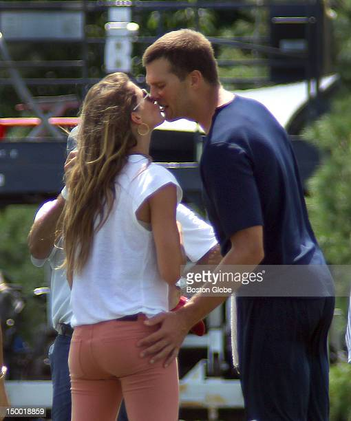 New England Patriots quarterback Tom Brady gives his wife Gisele Bundchen a kiss at the end of practice The New England Patriots held practice with...