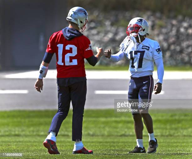New England Patriots quarterback Tom Brady greets New England Patriots wide receiver Antonio Brown during New England Patriots practice at Gillette...