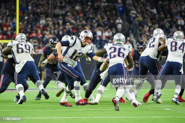 New England Patriots quarterback Tom Brady hands off to New England Patriots running back Sony Michel during the football game between the New...