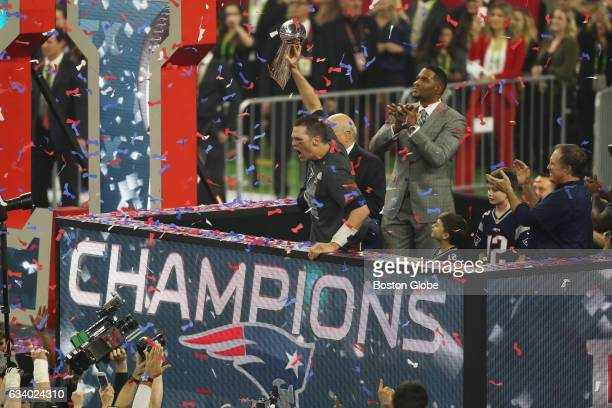 New England Patriots quarterback Tom Brady holds up the Lombardi Trophy after winning Super Bowl LI The Patriots defeated the Atlanta Falcons in...