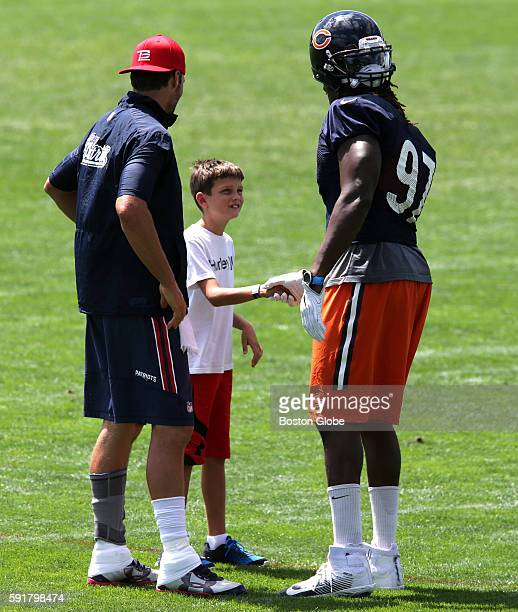 New England Patriots quarterback Tom Brady introduces his son John Edward Thomas Moynahan to Chicago Bears outside linebacker Willie Young after...