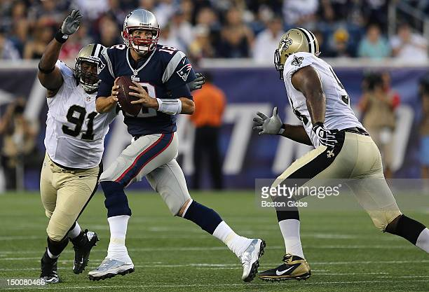 New England Patriots quarterback Tom Brady is chased out of the pocket during the first quarter of a preseason exhibition game against the New...