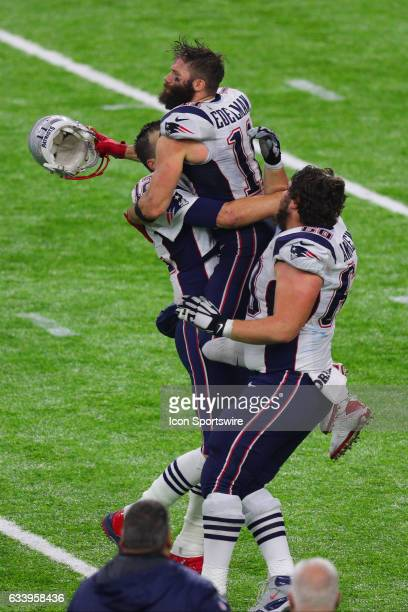 New England Patriots Quarterback Tom Brady is congratulated by New England Patriots Wide Receiver Julian Edelman and New England Patriots Center...