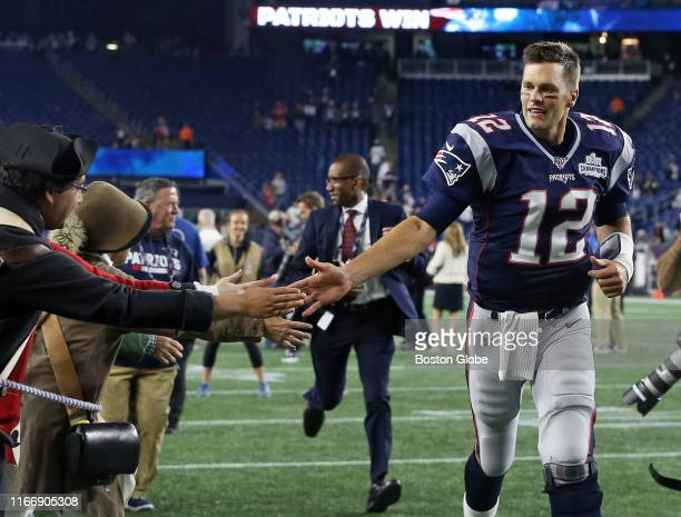 New England Patriots quarterback Tom Brady is pictured as he heads off the field following New England's 33-3 victory. The New England Patriots host...