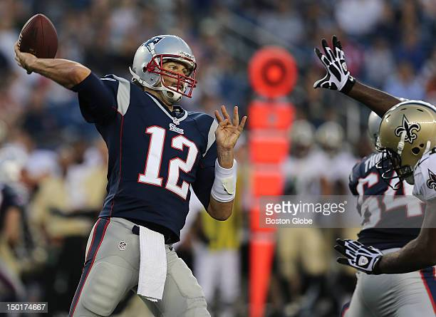 New England Patriots quarterback Tom Brady is pressured by a New Orleans Saints defender during the first quarter of a preseason exhibition game at...