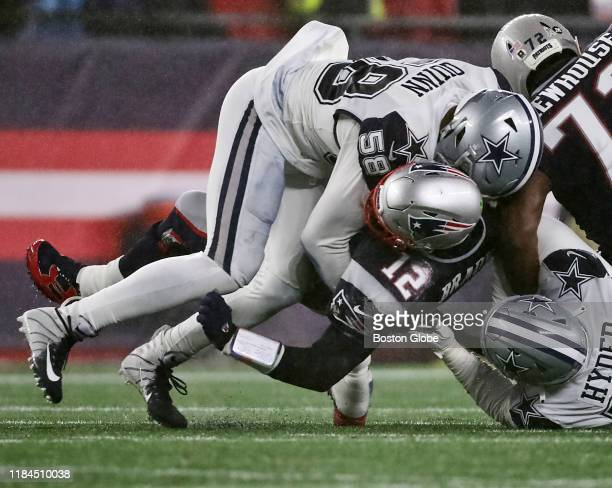 New England Patriots quarterback Tom Brady is sacked by Dallas Cowboys defensive end Robert Quinn during the second quarter The New England Patriots...