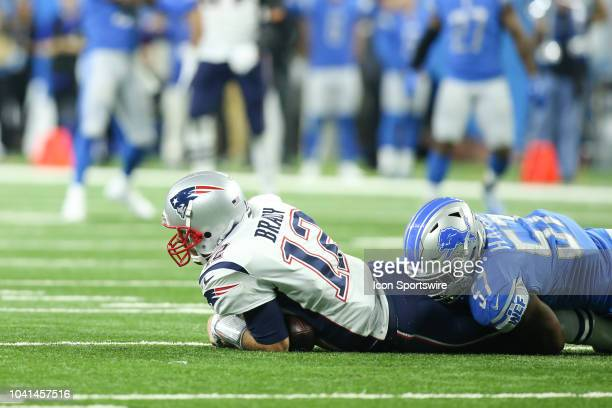New England Patriots quarterback Tom Brady is sacked by Detroit Lions linebacker Eli Harold during a regular season game between the New England...