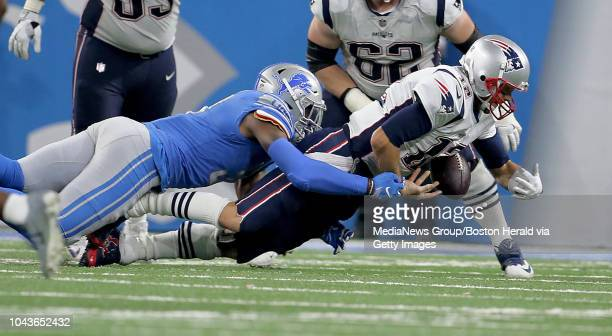 New England Patriots quarterback Tom Brady is sacked by Detroit Lions linebacker Eli Harold during the fourth quarter of the game at Ford Field on...