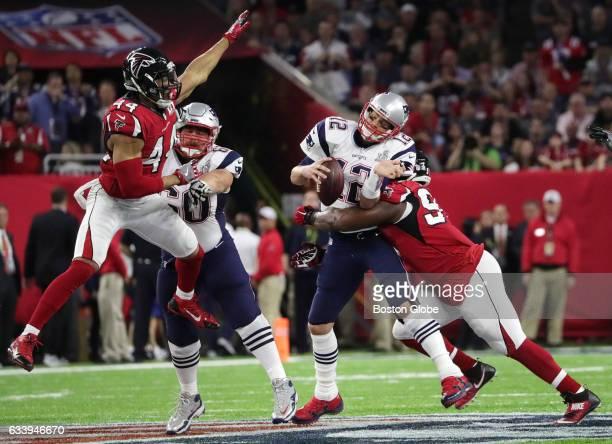 New England Patriots quarterback Tom Brady is sacked during the first quarter The Atlanta Falcons play the New England Patriots in Super Bowl LI at...