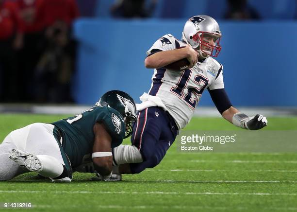 New England Patriots quarterback Tom Brady is tackled by the Eagles Brandon Graham as he tries to scramble for some late first half yardage The New...