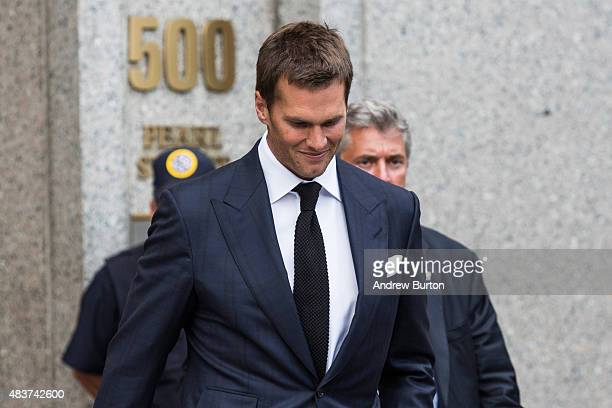 New England Patriots quarterback Tom Brady leaves federal court after appealing the National Football League's decision to suspend him for four games...