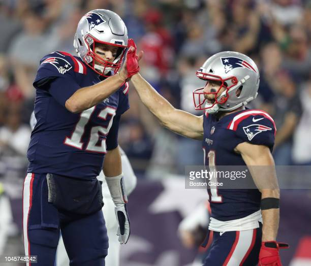 New England Patriots quarterback Tom Brady left and teammate Julian Edelman highfive in the second quarter The New England Patriots host the...