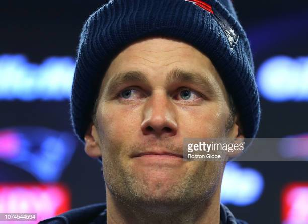 New England Patriots quarterback Tom Brady listens to a question about former teammate Josh Gordon during a media availability following New England...