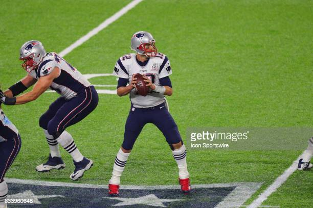 New England Patriots Quarterback Tom Brady look to pass on the final drive in overtime during the New England Patriots 3428 victory over the Atlanta...
