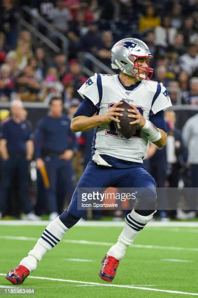 New England Patriots quarterback Tom Brady looks to pass down field during second half touchdown during the football game between the New England...