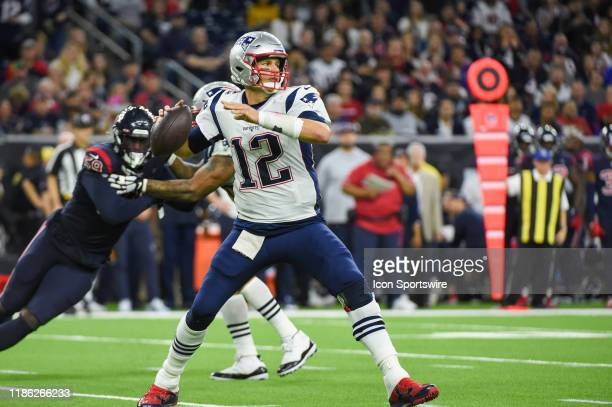 New England Patriots quarterback Tom Brady looks to pass down field during the football game between the New England Patriots and Houston Texans at...