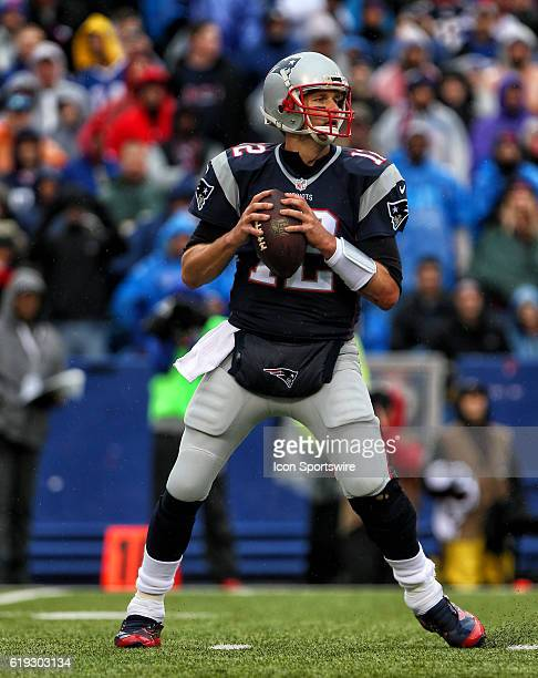 New England Patriots quarterback Tom Brady looks to pass during a NFL game between the New England Patriots and Buffalo Bills on October 30 at New...