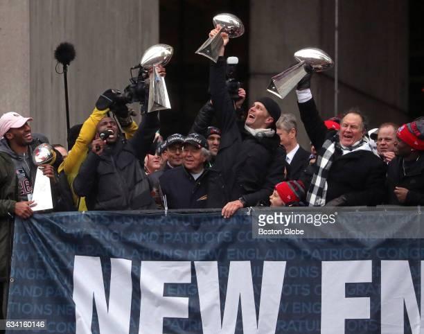 New England Patriots quarterback Tom Brady New England Patriots head coach Bill Belichick and New England Patriots free safety Devin McCourty hoist...