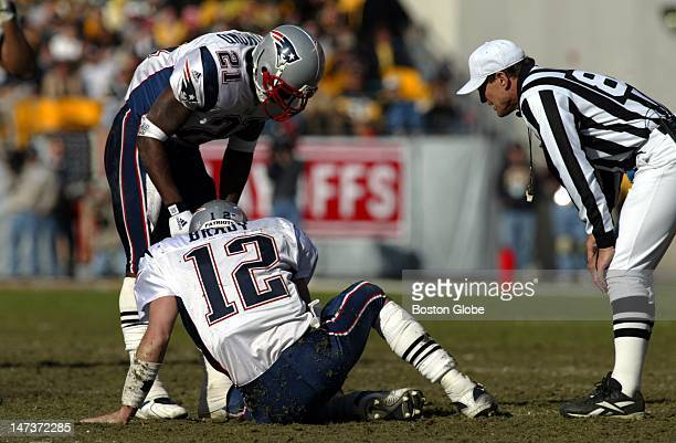 New England Patriots quarterback Tom Brady on the ground at Heinz Field after being injured during the AFC championship game against the Pittsburgh...