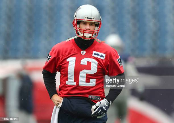 New England Patriots quarterback Tom Brady participates in warmups at Gillette Stadium in Foxborough Mass Jan 17 2018 Brady was a limited participant...