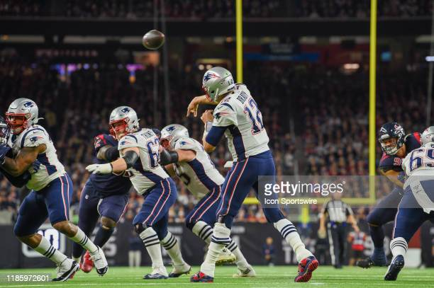 New England Patriots quarterback Tom Brady passes over the middle during first half action during the football game between the New England Patriots...