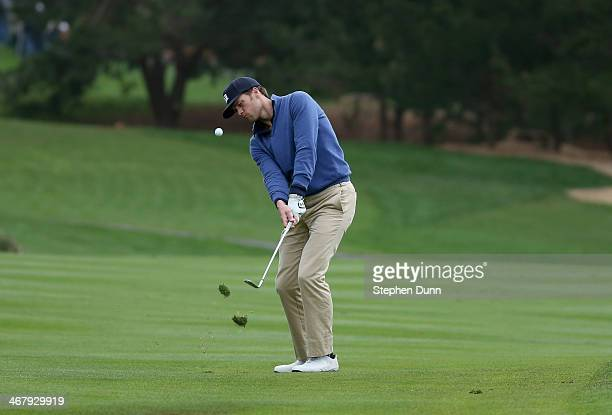 New England Patriots quarterback Tom Brady pitches onto the 13th green during the third round of the AT&T Pebble Beach National Pro-Am at the Pebble...