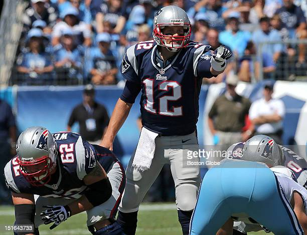 New England Patriots quarterback Tom Brady points out offensive alignments during first quarter action of the New England Patriots season opener...