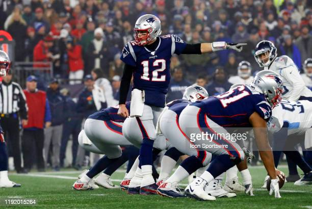 New England Patriots quarterback Tom Brady points out trouble to his back during an AFC Wild Card game between the New England Patriots and the...